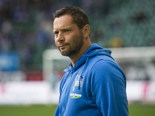 Hertha Berlin's Hungarian head coach Pal Dardai watch his team warm up prior to the German first division Bundesliga football match VfL Wolfsburg vs Hertha BSC Berlin, in Wolfsburg, northern Germany on September 19, 2015