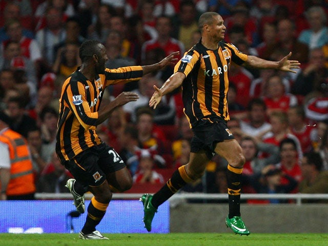 Daniel Cousin of Hull City celebrates with teammates after scoring during the Barclays Premier League match between Arsenal and Hull City at the Emirates Stadium on September 27, 2008