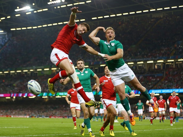 Matt Evans of Canada and Luke Fitzgerald of Ireland challenge for the high ball during the 2015 Rugby World Cup Pool D match between Ireland and Canada at the Millennium Stadium on September 19, 2015
