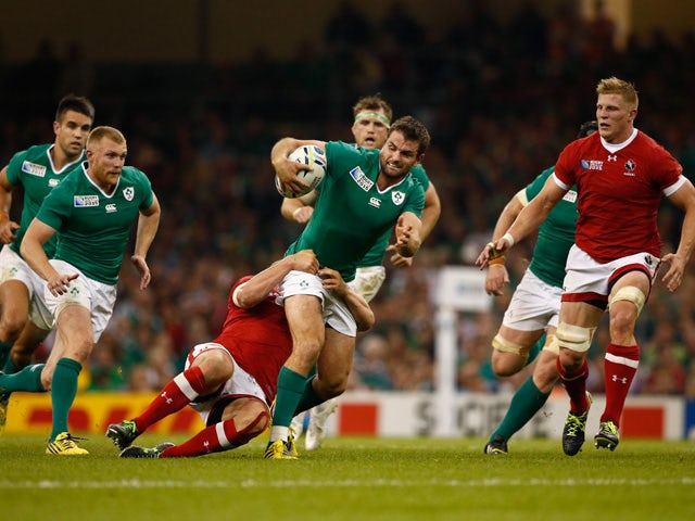 Jared Payne of Ireland looks to offload to Keith Earls of Ireland during the 2015 Rugby World Cup Pool D match between Ireland and Canada at the Millennium Stadium on September 19, 2015