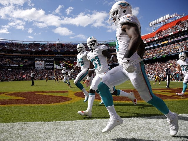 Jarvis Landry of the Miami Dolphins celebrates a touchdown against the Washington Redskins on September 13, 2015