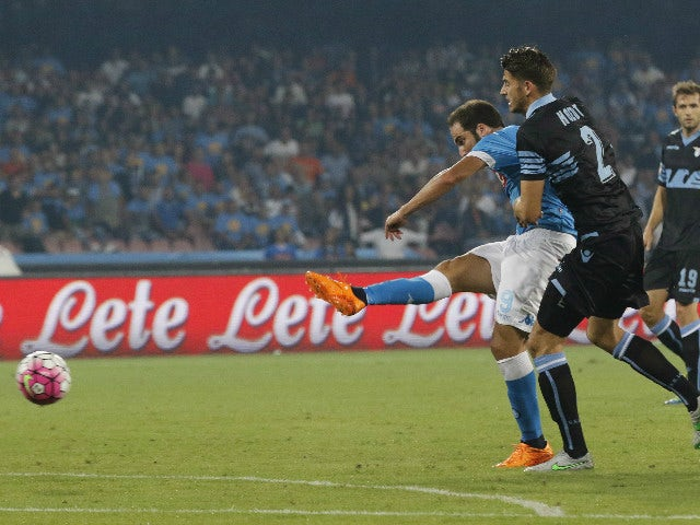 Napoli's Argentinian-French forward Gonzalo Higuain (L) scores past Lazio's Dutch defender Wesley Hoedt during the Italian Serie A football match SSC Napoli vs SS Lazio on September 20, 2015 at the San Paolo stadium in Naples.