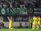 Villarreal's Leo Baptistao (L) celebrates the 0-1 during the UEFA Europa League Group E football match between SK Rapid Wien and Villarreal CF in Vienna, Austria, on September 17, 2015.