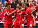 Danny Ings of Liverpool (28) celebrates with team mates as he scores their first goal during the Barclays Premier League match between Liverpool and Norwich City at Anfield on September 20, 2015
