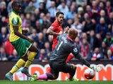 Liverpool's English striker Danny Ings scores his team's first goal past Norwich City's English goalkeeper John Ruddy (R) during the English Premier League football match between Liverpool and Norwich City at the Anfield stadium in Liverpool, north-west E