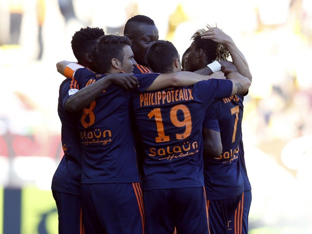 Lorient's forward Ibrahim Didier Ndong (R) celebrates with teammates after scoring a goal during the French L1 football match Monaco (ASM) vs Lorient (FCL) on September 20, 2015