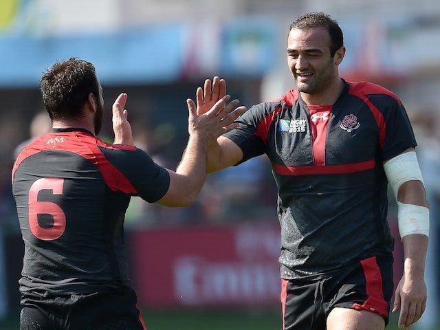 Tonga's Mamuka Gorgodze celebrates his try with teammate Sione Kalamafoni during the Rugby World Cup game with Georgia on September 19, 2015