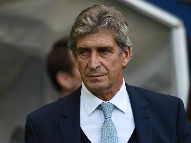 Manchester City's Chilean manager Manuel Pellegrini arrives for the English Premier League football match between Manchester City and West Ham United at The Etihad Stadium in Manchester, north west England on September 19, 2015.