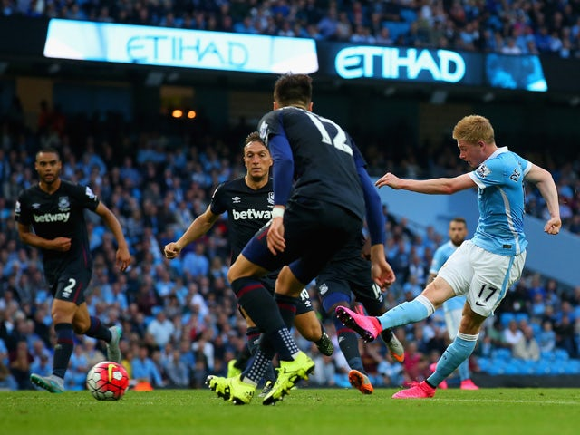 Kevin de Bruyne of Manchester City scores his team's first goal during the Barclays Premier League match between Manchester City and West Ham United at Etihad Stadium on September 19, 2015
