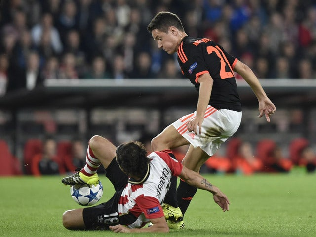 Manchester's Spanish midfielder Ander Herrera (R) vies with Eindhoven's Mexican midfielder Andres Guardado (L) during the UEFA Champions League Group B football match between PSV Eindhoven and Manchester United at the Philips stadium in Eindhoven, Belgium