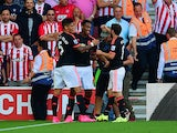 Anthony Martial of Manchester United celebrates scoring the opening goal with Marcos Rojo and Juan Mata of Manchester United during the Barclays Premier League match between Southampton and Manchester United at St Mary's Stadium on September 20, 2015