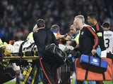 Manchester's Luke Shaw leaves the field after being injured during the UEFA Champions League Group B football match between PSV Eindhoven and Manchester United at the Philips stadium in Eindhoven, Belgium on September 15, 2015