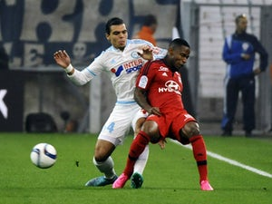Ten-man Marseille fight back to secure draw