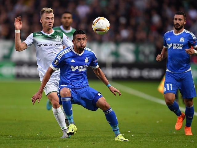 Marseille's Chilean Mauricio Isla (C) vies with Groningen's Slovenian Alkbert Rusnak during the UEFA Europe League Group F football match between FC Groningen and Olympique Marseille at the Euroborg stadium in Groningen, Netherlands on September 17, 2015.