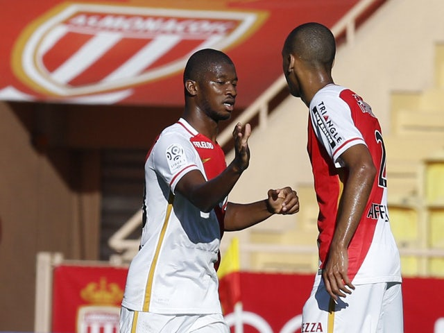 Monaco's Malian defender Almamy Toure (L) celebrates with a teammate after scoring a goal during the French L1 football match Monaco (ASM) vs Lorient (FCL) on September 20, 2015