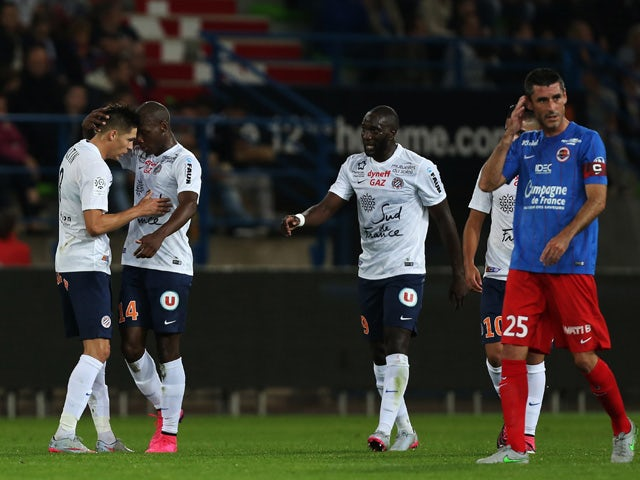 Montpellier's French midfielder Jonas Martin (L) celebrates after scoring during the French L1 football match between Stade Malherbe de Caen (SMC) and Montpellier (MHSC) on September 17, 2015