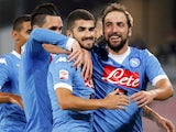 Napoli's Argentinian-French forward Gonzalo Higuain (R) celebrates with teammates after scoring during the Italian Serie A football match SSC Napoli vs SS Lazio on September 20, 2015 at the San Paolo stadium in Naples.