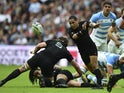 New Zealand's scrum half Aaron Smith passes the ball during a Pool C match of the 2015 Rugby World Cup between New Zealand and Argentina at Wembley stadium, north London on September 20, 2015