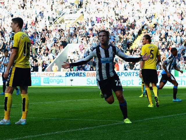 Daryl Janmaat of Newcastle United celebrates scoring his team's first goal during the Barclays Premier League match between Newcastle United and Watford at St James' Park on September 19, 2015 in Newcastle upon Tyne, United Kingdom.