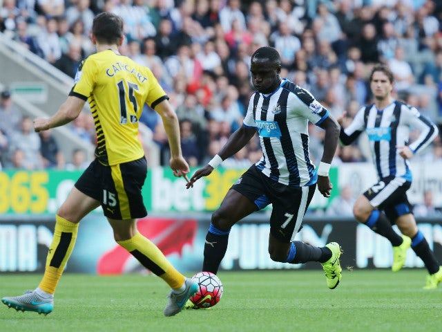 Moussa Sissoko of Newcastle United and Craig Cathcart of Watford compete for the ball during the Barclays Premier League match between Newcastle United and Watford at St James' Park on September 19, 2015 in Newcastle upon Tyne, United Kingdom.