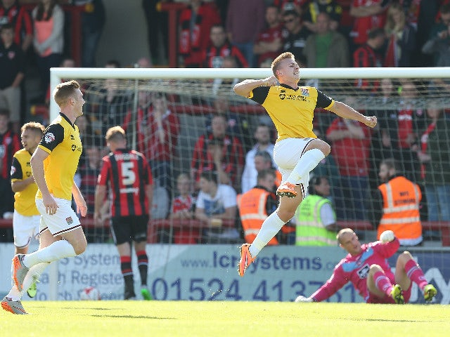 Sam Hoskins of Northampton Town celebrates after scoring his sides 2nd goal during the Sky Bet League Two match between Morecambe and Northampton Town at Globe Arena on September 19, 2015 in Morecambe, England.