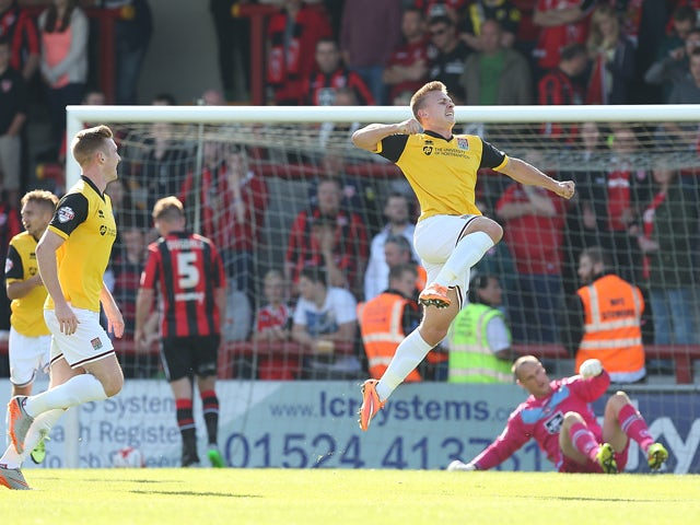 Sam Hoskins of Northampton Town celebrates after scoring his sides 2nd goal during the Sky Bet League Two match between Morecambe and Northampton Town at Globe Arena on September 19, 2015