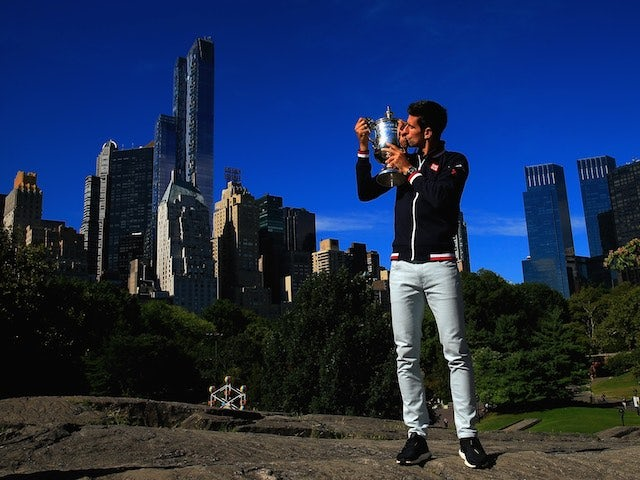 US Open champion Novak Djokovic poses with the trophy in New York