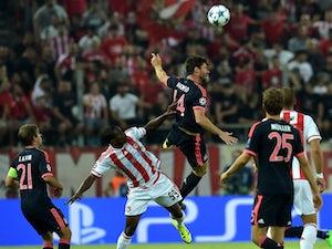 Olympiacos hold Bayern Munich at break