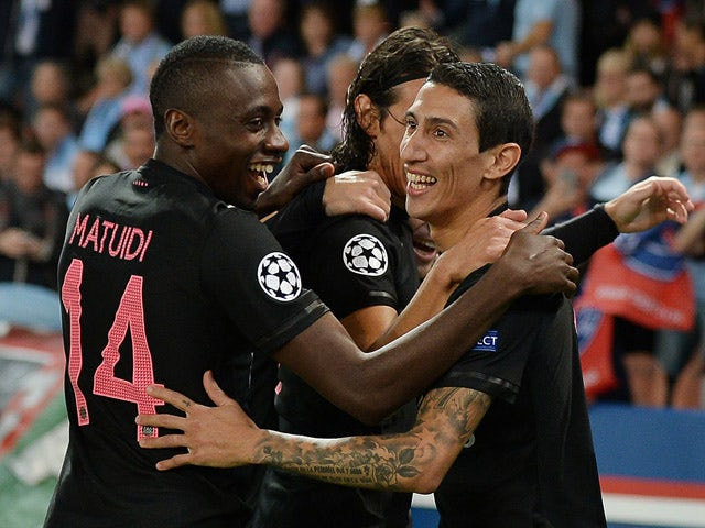 Paris Saint-Germain's Argentinian forward Angel Di Maria (R) celebrates with teammates after scoring a goal during the UEFA Champions League group A football match between Paris Saint Germain (PSG) and Malmo FF on September 15, 2015