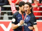 Paris Saint-Germain's Uruguayan forward Edinson Cavani is congratulated by his teammate on scoring during the French Ligue 1 football match between Reims and Paris Saint-Germain on September 19, 2015