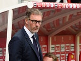 Paris Saint-Germain's French head coach Laurent Blanc looks on during the French Ligue 1 football match between Reims and Paris Saint-Germain on September 19, 2015