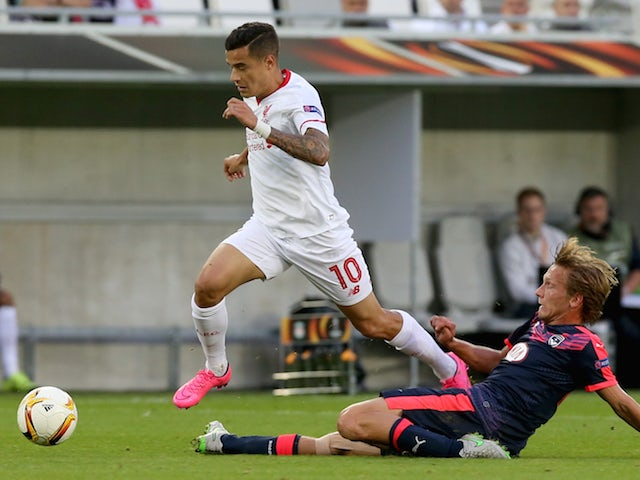 Philippe Coutinho for Liverpool FC is tackled by Clement Chantome for FC Girondins de Bordeaux during the Europa League game between FC Girondins de Bordeaux and Liverpool FC at Matmut Atlantique Stadium on September 17, 2015 in Bordeaux, France.