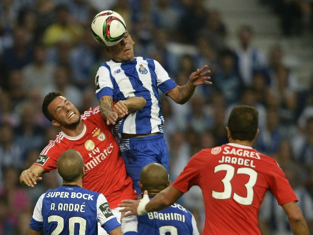 Porto's Uruguayan defender Maxi Pereira (R) heads the ball with Benfica's Greek midfielder Andreas Samaris during the Portuguese league football match FC Porto vs SL Benfica at the Dragao stadium in Porto, on September 20, 2015.