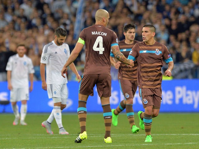 Players of FC Porto reacts after a goal during the UEFA Champions league group G football match between FC Dynamo Kiev and FC Porto at Olimpiysky stadium in Kiev on September 16, 2015