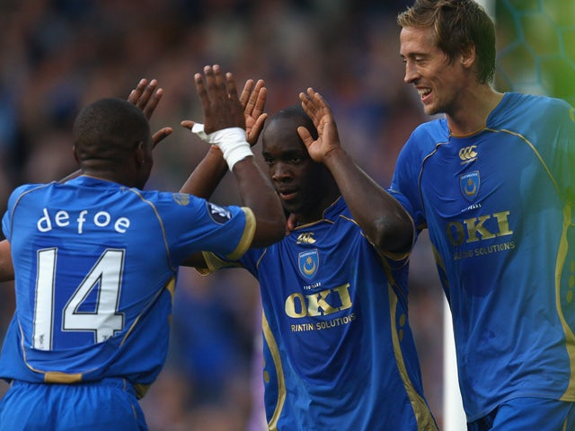 Lassana Diarra of Portsmouth celebrates with his team-mates after scoring the first goal for Portsmouth during the UEFA Cup round one first leg match between Portsmouth and Guimaraes at Fratton Park on September 18, 2008