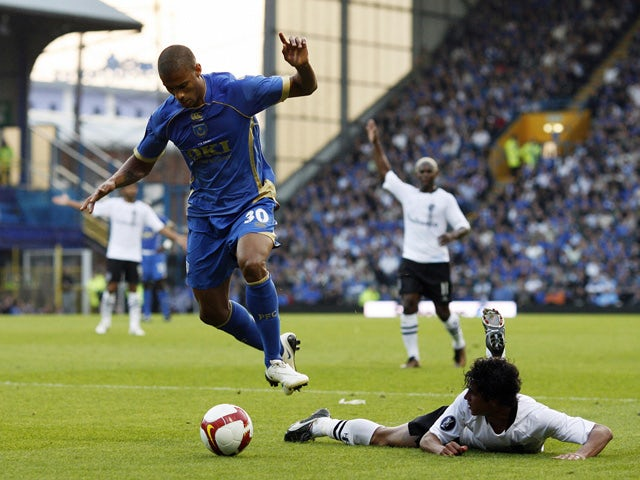 Portsmouth's Malian defender Djimi Traore vies with Guimaraes' Brazilian defender Andrezinho during their UEFA Cup, first round, first leg match against Vitoria Guimaraes at Fratton Park, Portsmouth, England, on September 18, 2008