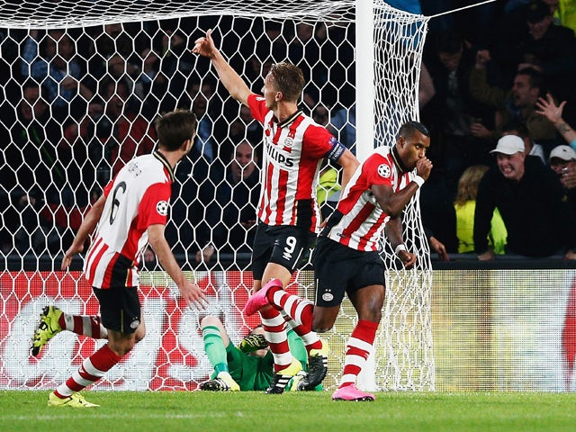 Luciano Narsingh of PSV Eindhoven celebrates scoring his team's second goal during the UEFA Champions League Group B match between PSV Eindhoven and Manchester United at PSV Stadion on September 15, 2015