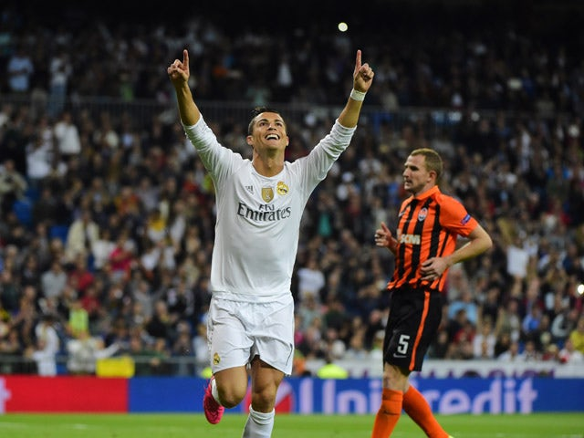 Real Madrid's Portuguese forward Cristiano Ronaldo celebrates his second goal during the UEFA Champions League group A football match Real Madrid CF vs FC Shakhtar Donetsk at the Santiago Bernabeu stadium in Madrid on September 15, 2015