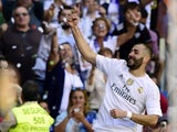 Real Madrid's French forward Karim Benzema celebrates after scoring a goal during the Spanish league football match Real Madrid CF vs Granada FC at the Santiago Bernabeu stadium in Madrid on Spetember 19, 2015