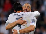 Karim Benzema of Real Madrid celebrates with Cristiano Ronaldo after scoring Real's opening goal during the UEFA Champions League Group A match between Real Madrid and Shakhtar Donetsk at estadio Santiago Bernabeu on September 15, 2015