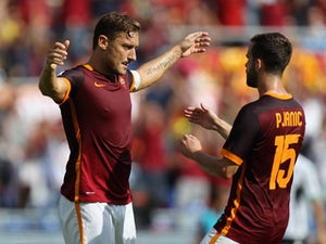 Roma fight back to hold Sasuolo
