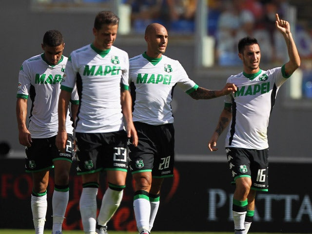 Matteo Politano (R) celebrates with his teammates of US Sassuolo after scoring the team's second goal during the Serie A match between AS Roma and US Sassuolo Calcio at Stadio Olimpico on September 20, 2015