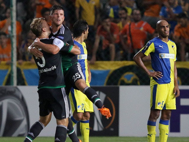 Schalke 04's Johannes Geis (L) and Klaas-Jan Huntelaar celebrate after scoring a goal during the UEFA Europa League football match between APOEL and Schalke 04 at the GSP Stadium in the Cypriot capital Nicosia on September 17, 2015