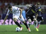 Grzegorz Krychowiak of Sevilla FC competes for the ball with Andre Hahn (R) of Borussia Monchengladbach during the UEFA Champions League Group D match between Sevilla FC and VfL Borussia Monchengladbach at Estadio Ramon Sanchez Pizjuan on September 15, 20