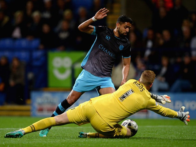 Atdhe Nuhiu of Sheffield Wednesday looks to get past Bolton goalkeeper Ben Amos during the Sky Bet Championship match between Bolton Wanderers and Sheffield Wednesday at Reebok Stadium on September 15, 2015