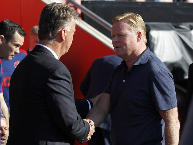 Southampton's Dutch manager Ronald Koeman (R) shakes hands with Manchester United's Dutch manager Louis van Gaal ahead of the English Premier League football match between Southampton and Manchester United at St Mary's Stadium in Southampton, southern Eng