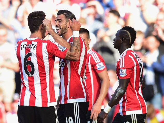 Graziano Pelle of Southampton (19) celebrates with team mates as he scores their first goal during the Barclays Premier League match between Southampton and Manchester United at St Mary's Stadium on September 20, 2015