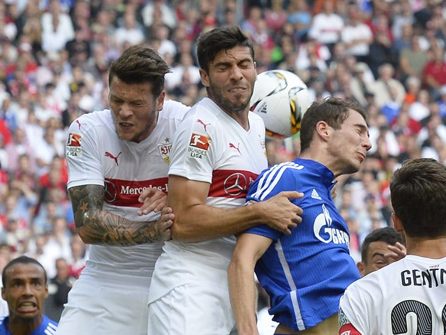 Stuttgart's forward Daniel Ginczek and Argentinian defender Emiliano Insua vie for the ball with Schalke's midfielder Leon Goretzka during the German first division Bundesliga football match VfB Stuttgart vs FC Schalke 04 in Stuttgart, southern Germany on