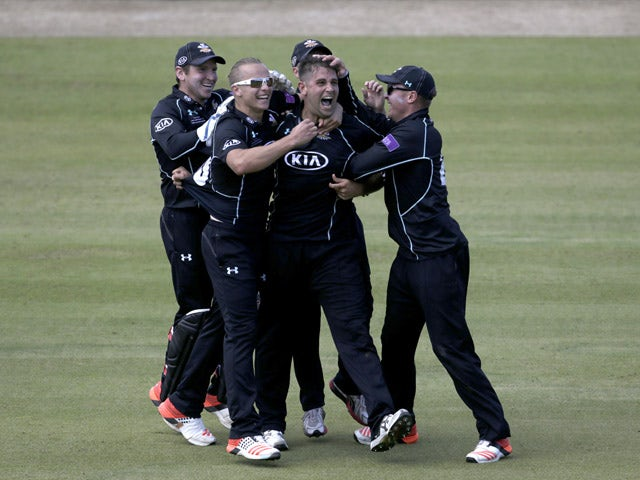 Jade Dernbach of Surrey celebrates the wicket of David Payne of Gloustershire during the Royal London One-Day Cup Final between Surrey and Gloustershire at Lord's Cricket Ground on September 19, 2015