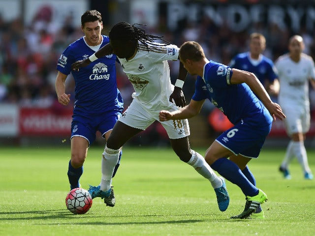 Bafetimbi Gomis of Swansea City and Phil Jagielka of Everton compete for the ball during the Barclays Premier League match between Swansea City and Everton at the Liberty Stadium on September 19, 2015 in Swansea, United Kingdom.